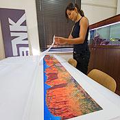 Soraya packs prints for shipping